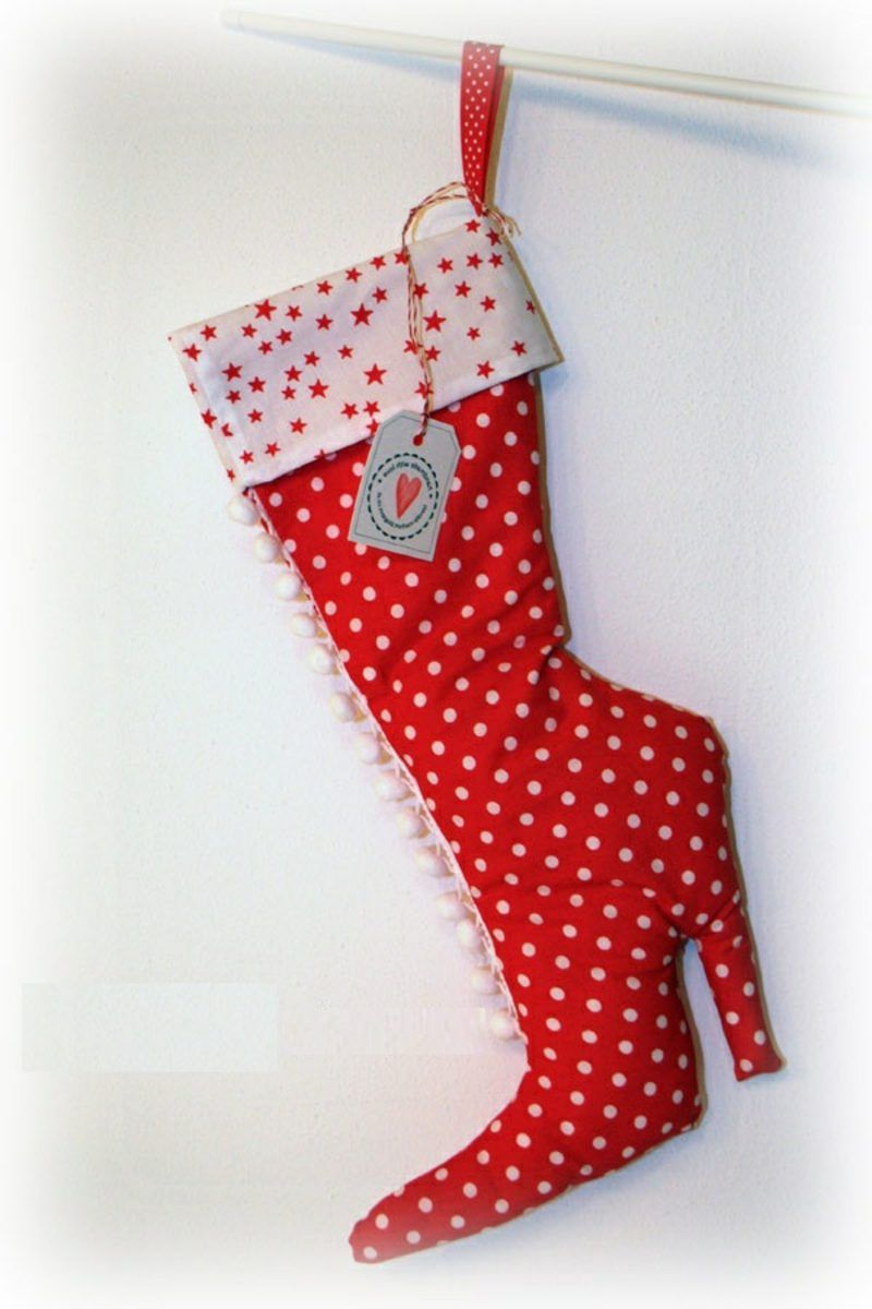 Photo of Sewing Santa Claus boots hanging on shoes boots