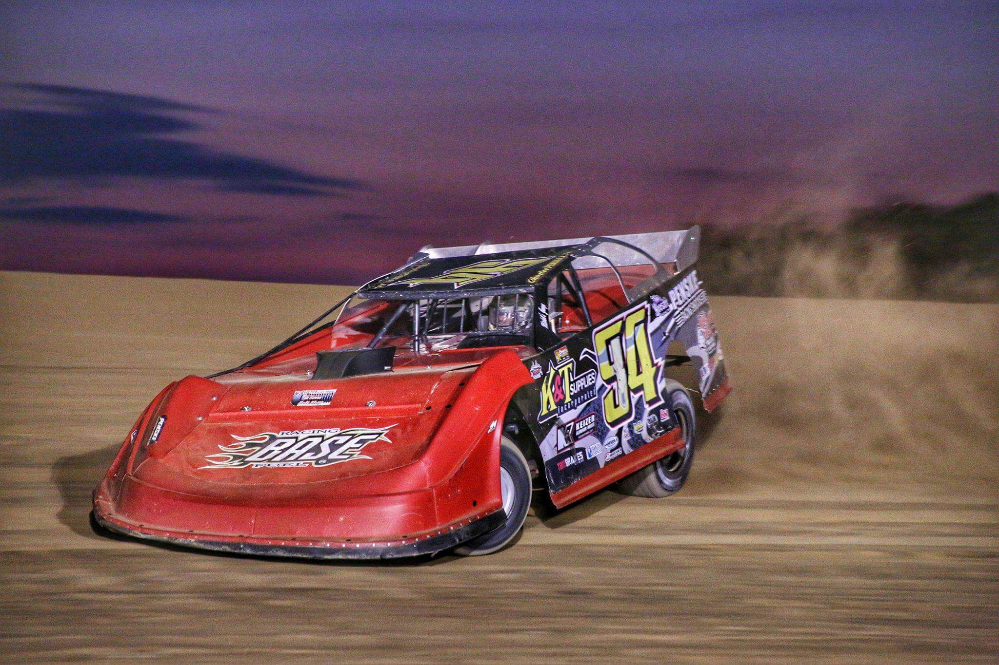 Watch the latest model stock cars zoom around a dirt race