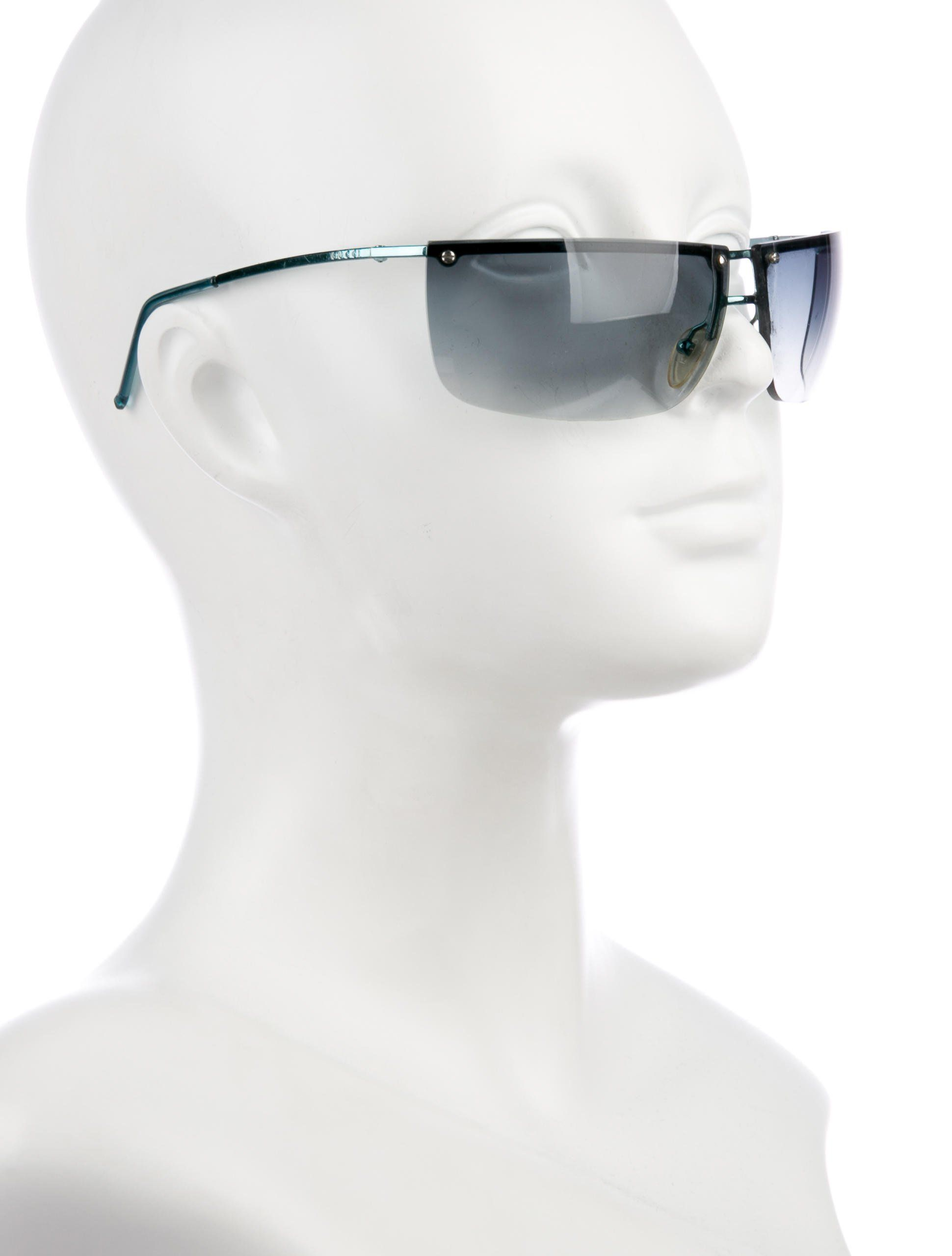 f78c63db2ec Aqua blue metal Gucci rimless sunglasses featuring etched logos at temples  and tonal gradient lenses.