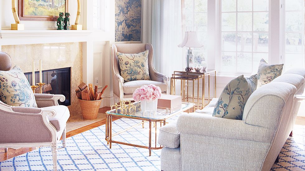 Designer Crush: Chloe Warner // traditional living room with blue toile wallpaper, check rug, and blossom pillows // Living Rooms