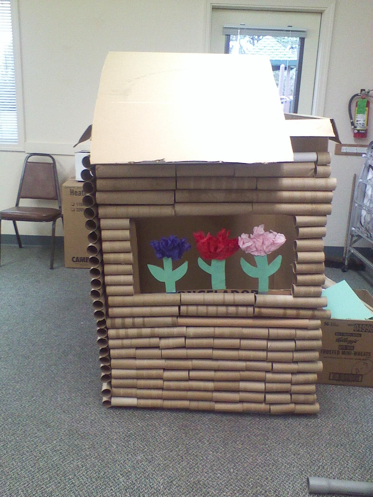 Log cabin created out of a card board box and paper towel for Crafts made out of paper towel rolls