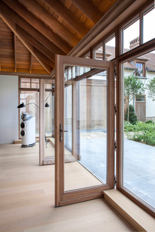 sleek wooden door and windows in afrormosia natural wood for …