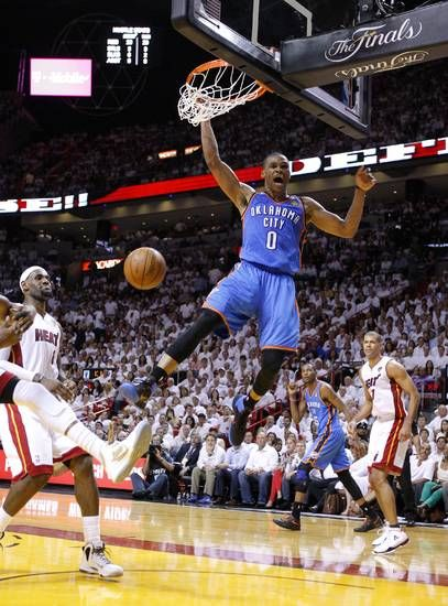 Oklahoma City S Russell Westbrook 0 Reacts After A Dunk As Miami S Lebron James 6 And Shane Bat Shane Battier Oklahoma City Thunder American Airlines Arena