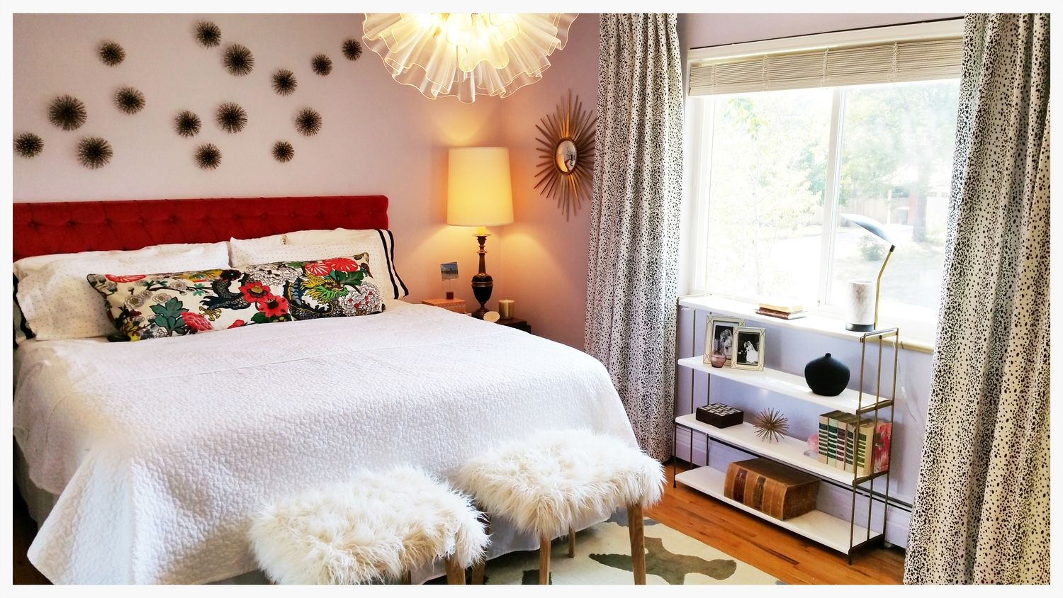 Bright and colorful master bedroom with statement light