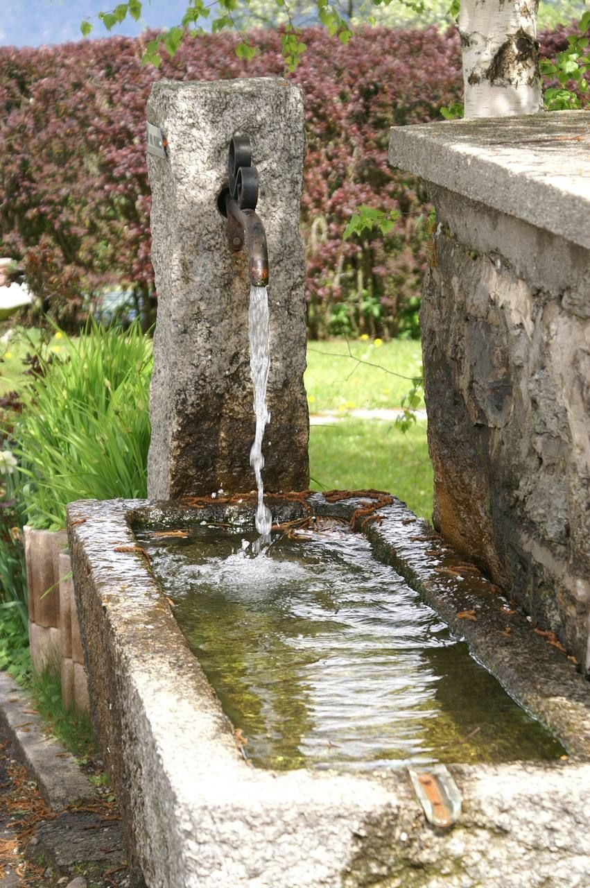 Stone Water Trough Makes A Natural Water Feature