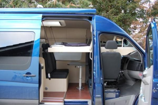 "DOMO 520 Sprinter conversion with both beds deployed - sleeping 4 people in a 118"" Sprinter van."
