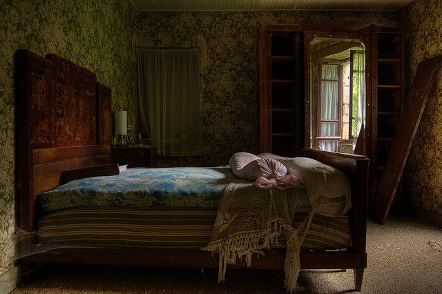 Beautiful bedroom in abandoned mansion.