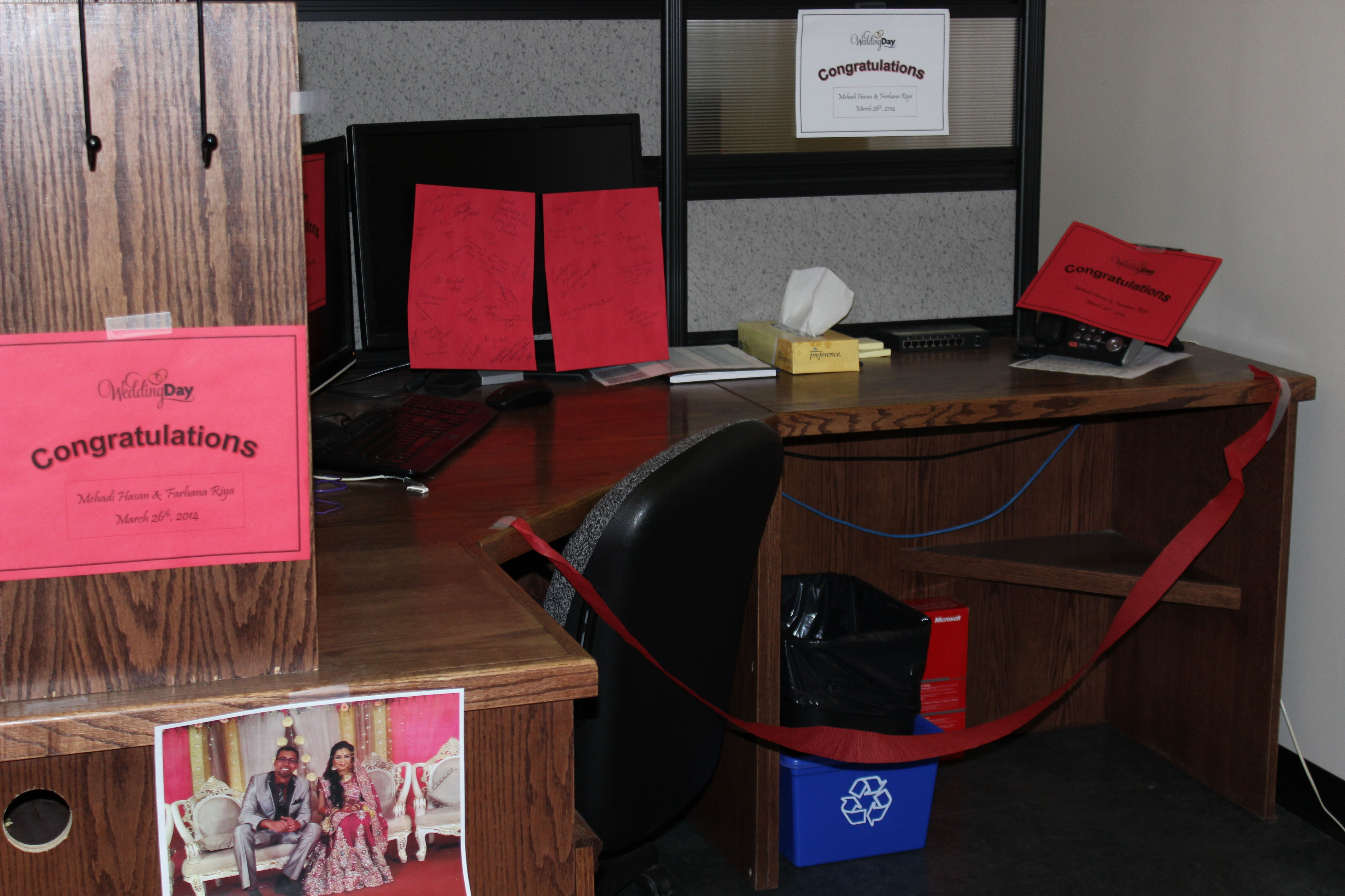 Congratulating our coworker on his wedding. Desk Surprise