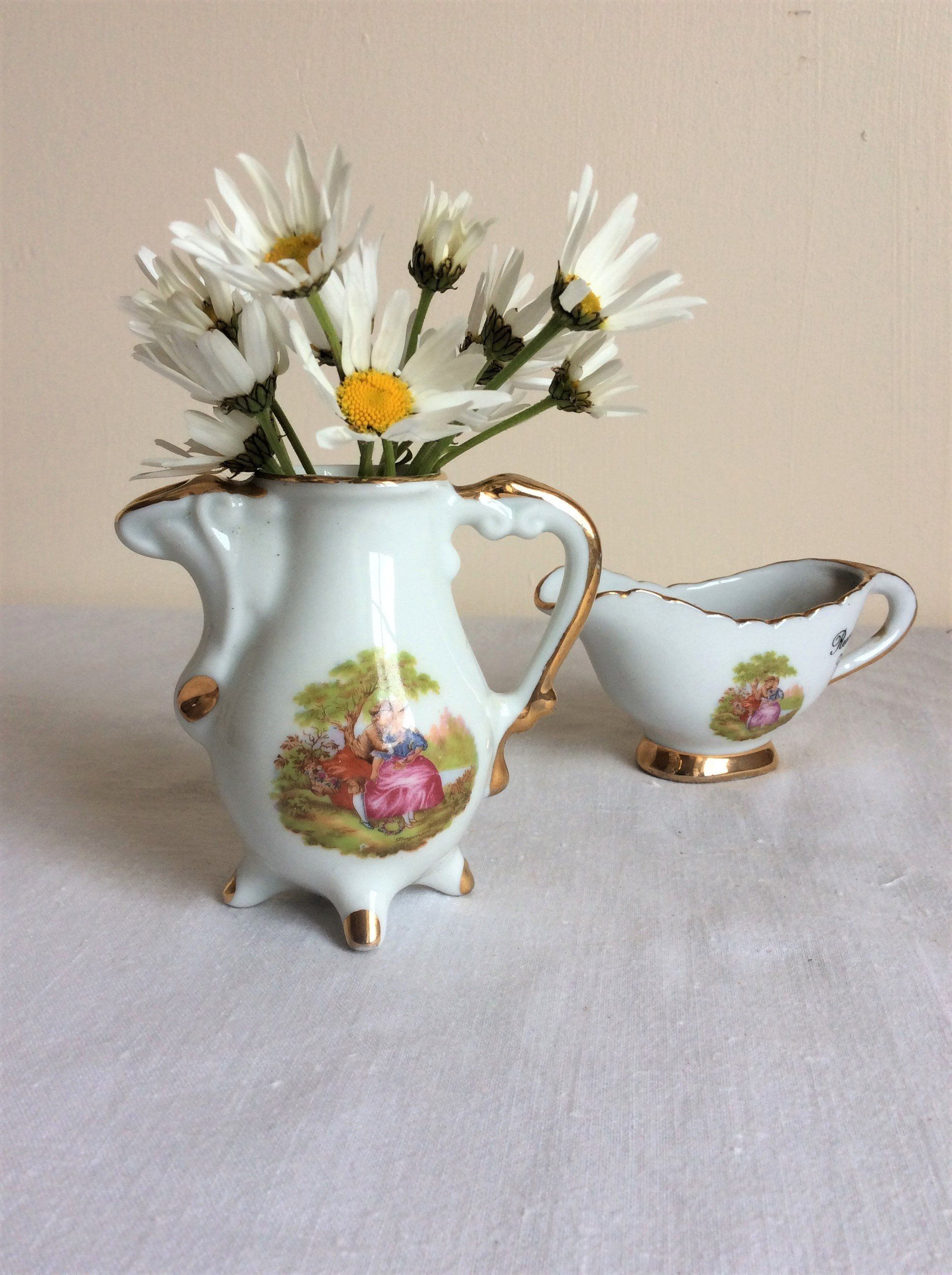 Collectible porcelain pitchers a set of 2 small french