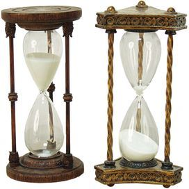 """Set of 2 hourglasses with carving-inspired details.   Product: 2-Piece hourglass setConstruction Material: Resin and glassColor: Brown and goldDimensions: 12"""" H x 6"""" Diameter"""