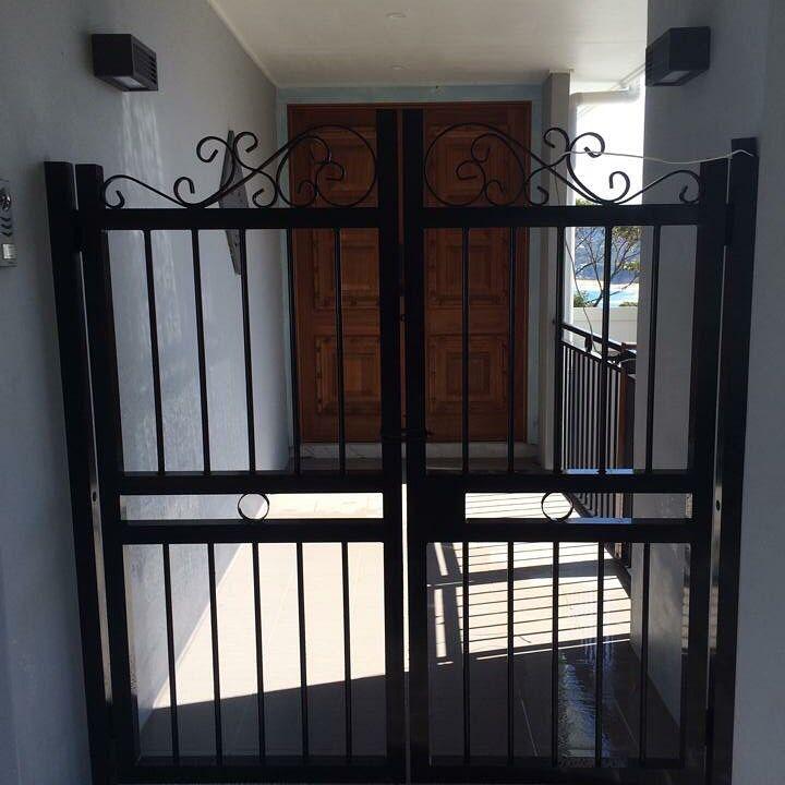 Tubular design black gate | Gate design, Fence design, Design