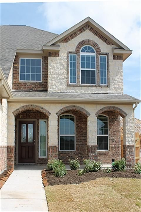 20714 kingsford trail lane richmond tx 77407 photo for Brick and stone elevations