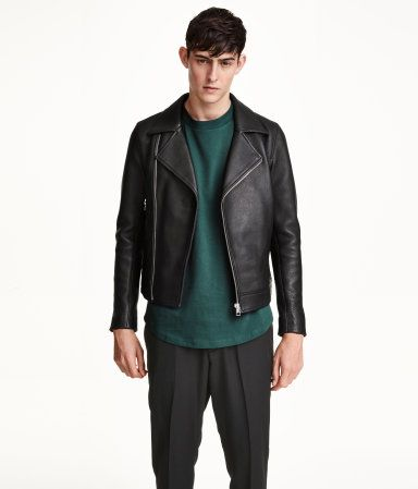 PREMIUM QUALITY. Biker jacket in leather. Lapels with concealed snap fastener, diagonal front zip, side pockets with zip, one inner pocket, and zips at cuffs. Lined.