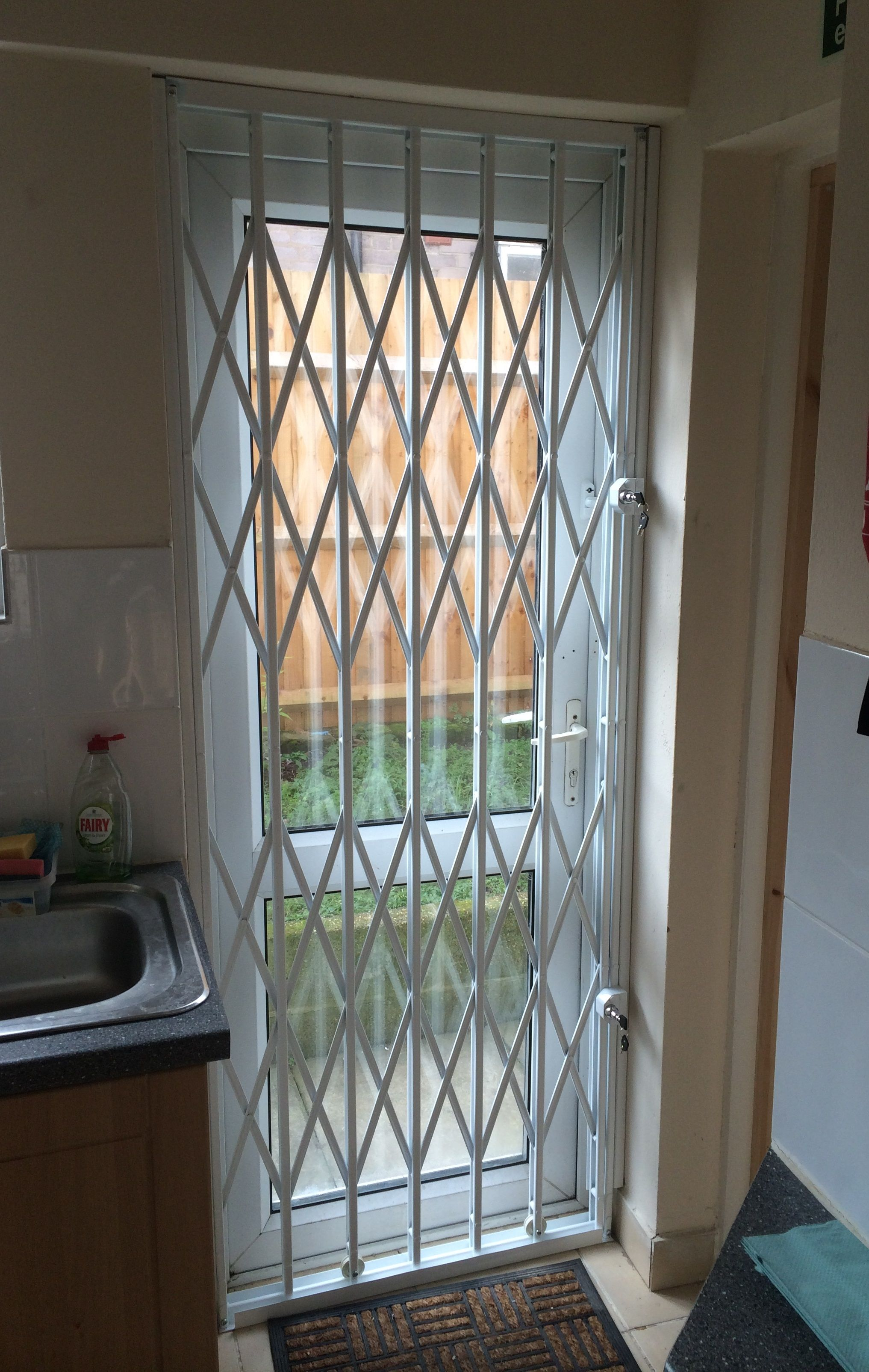 RSG1000 retractable security grille fitted to a kitchen ...