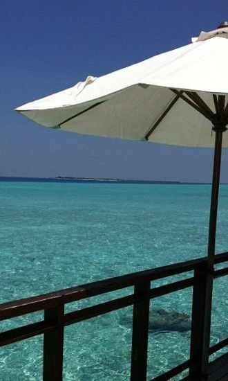 View from the deck from a water villa at Velassaru, in the Maldives, offers complete privacy in paradise. Velassaru is a dream of a hotel - fab design coupled with great service.