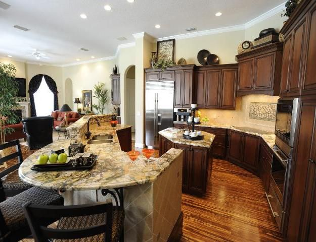 22 Kitchen Redesign Ideas and Latest Trends in Modern Kitchen Design-wooden kitchen cabinets in dark brown color and light stone countertops