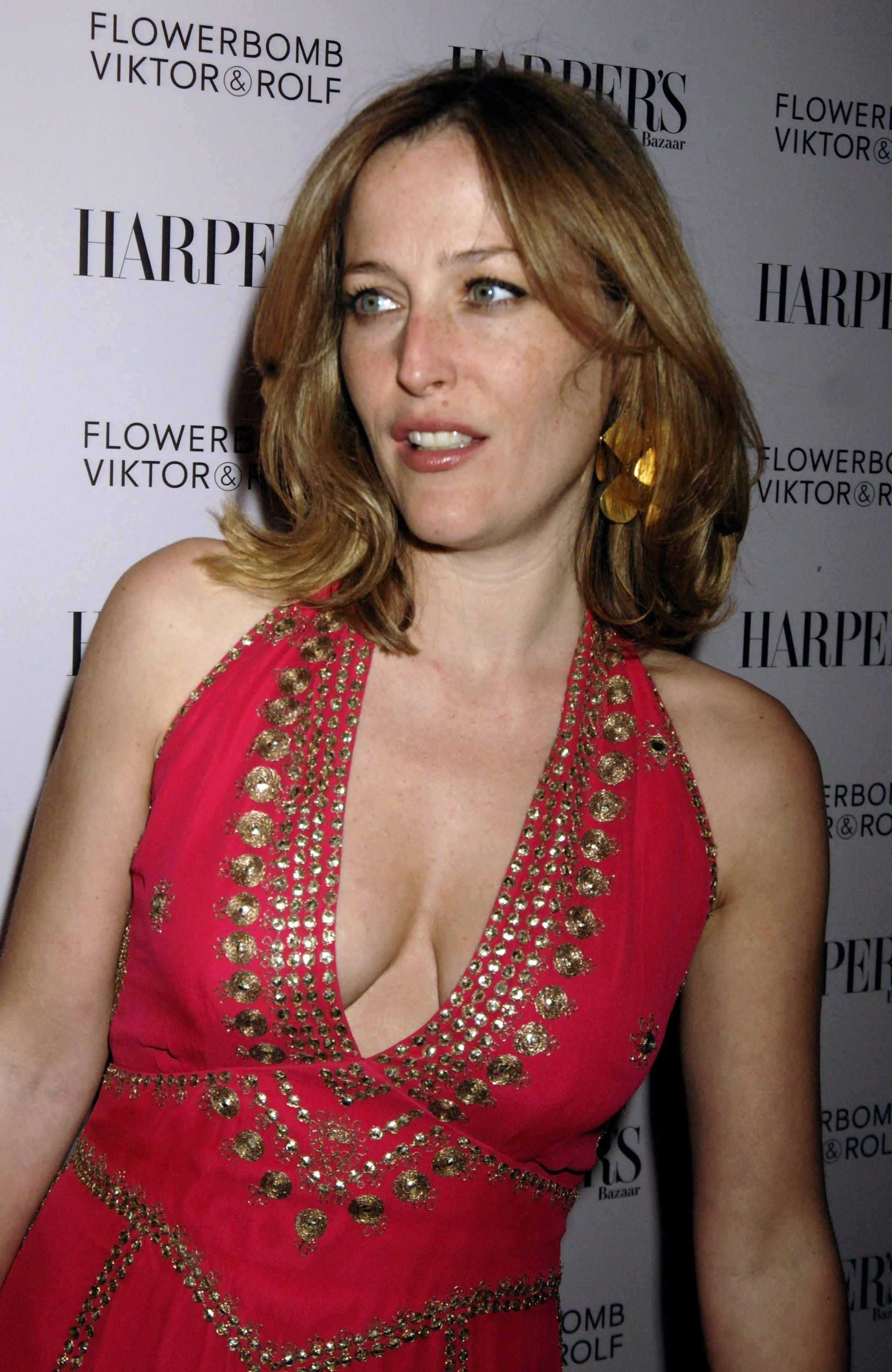 Gillian Anderson shines in silver as shes honoured with