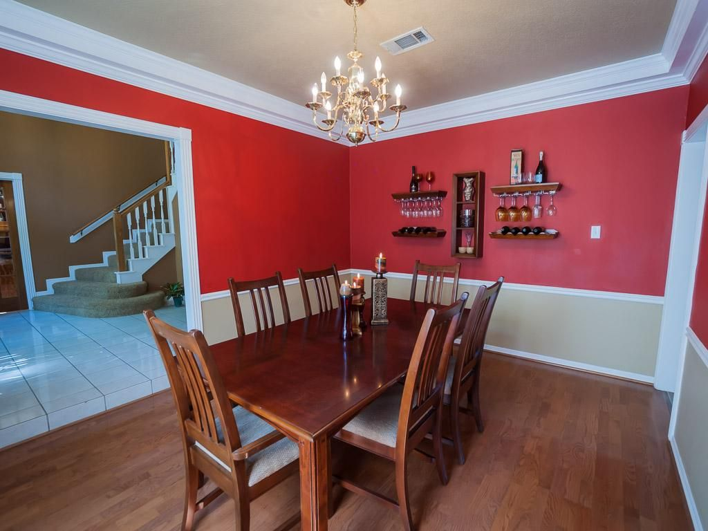 Cheerful red white two tone wall paint ideas feats vintage wooden dining sets and chandelier - Red dining room color ideas ...