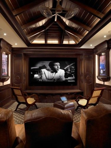 Eclectic media room by Pinto Designs and Associates