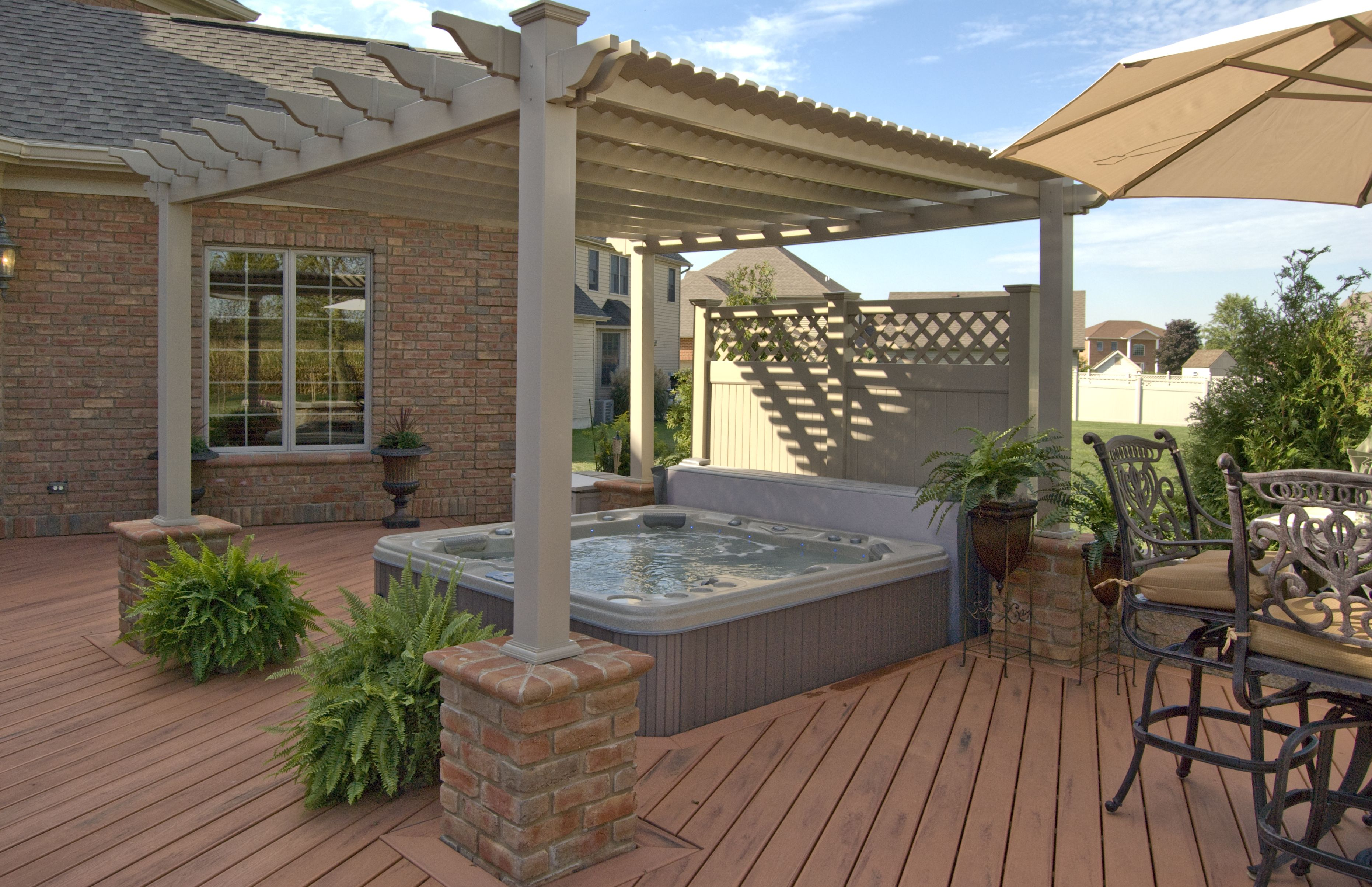 Addign a pergola over your hot tub is a great way to add for Deck gets too hot