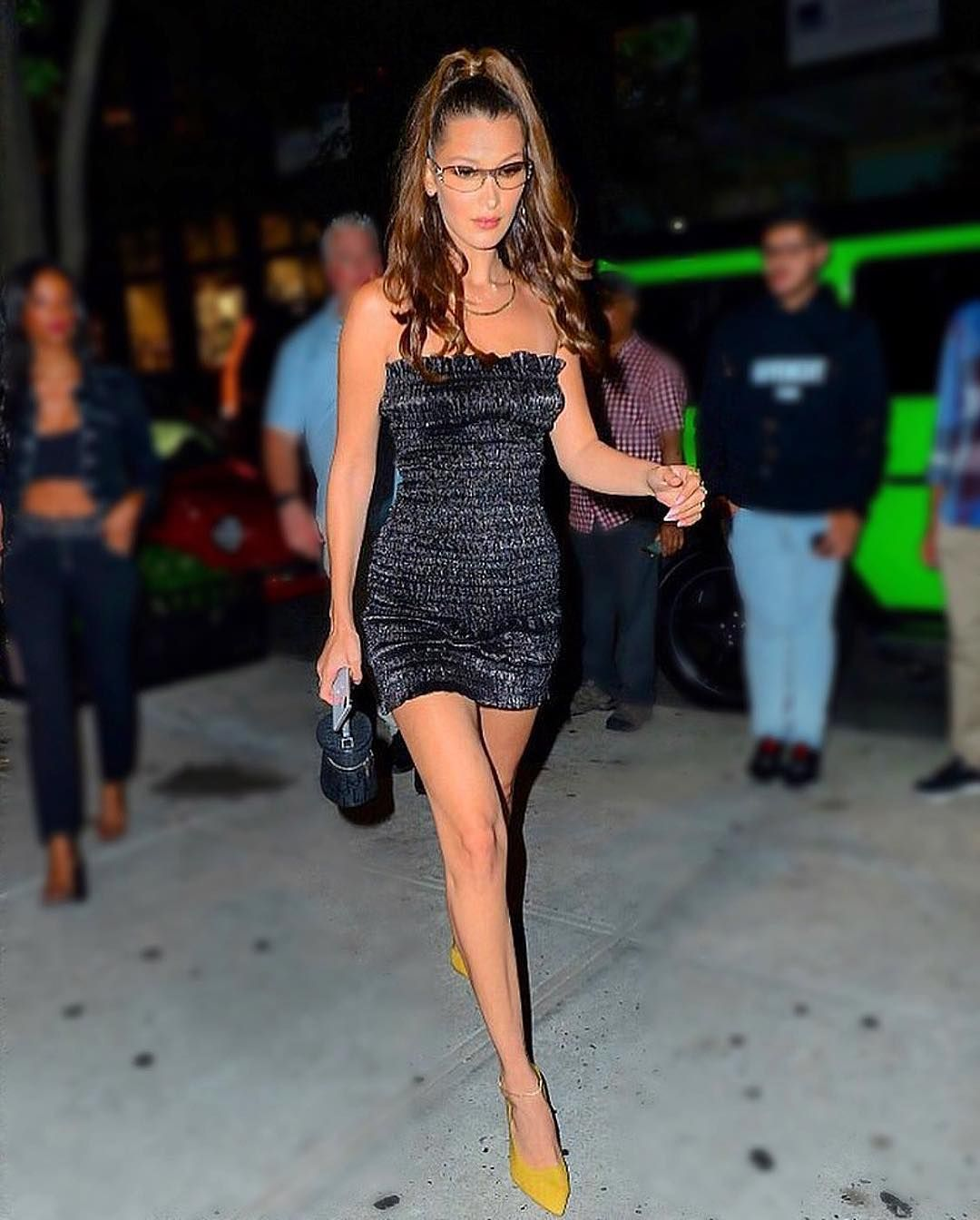 c526e6dc4 #ISpyBNY: Bella Hadid strutting down the streets in an exclusive-to-Barneys  Area dress. Tap to shop this black, tube dress now on Barneys.com.