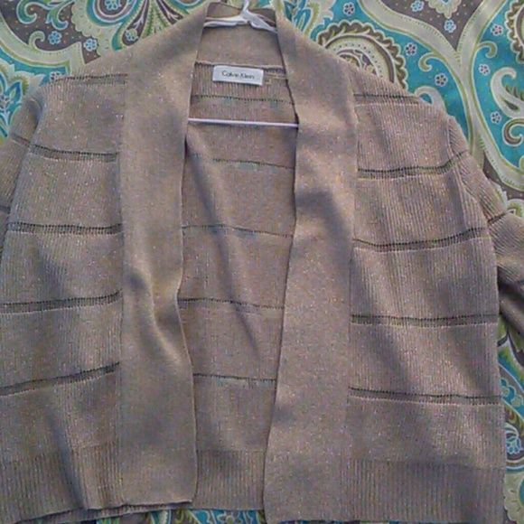 Calvin klien cardigan Fashionable sparkly tanned cardigan. MAKE BEST OFFER Calvin Klein Sweaters Cardigans