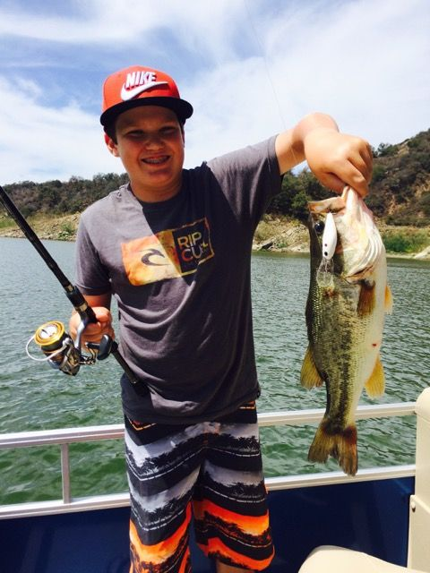 08/13/2015 look at the lunker bass this young angler caught on his Lake Casitas Fishing Guide Trip with Rich Tauber on a beautiful and scenic day, at Lake Casitas, in the beautiful Los Padres national forest. His smile says it all on how the fishing was.