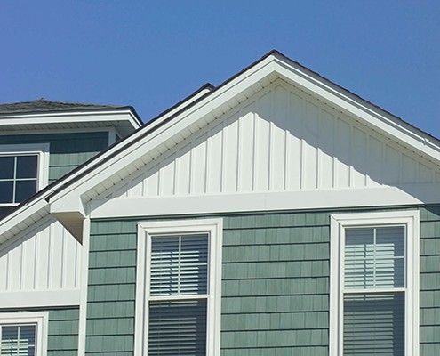 Board and batten siding features from prairie home for Pictures of houses with board and batten siding