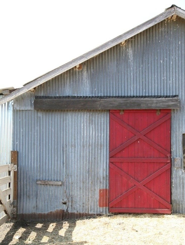 Facade Fix 9 Ways To Add Curb Appeal With Corrugated Metal Siding Gardenista Corrugated Metal Siding Metal Siding Red Barn Door
