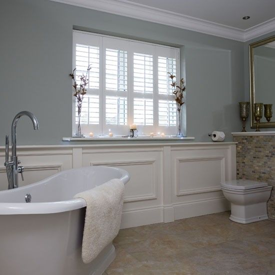 White shutters  wall panelling and an elegant roll top bath lend a  traditional note. John Lewis Croft Collection Blakeney   Bathroom ideas photo