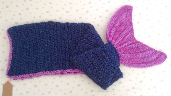 This is a beautifully soft mermaid tail blanket for your little one to snuggle into whilst imagining undersea adventures! The main body is crochet from super soft homespun yarn in a variegated colonial blue colour, and is complemented with a purple/pink fin and trim detail. This blanket is for up to 3 years. Can be done in other sizes, please message me for details and prices. Yarn used is 100% premium acrylic, therefore is machine washable on wool cycle.