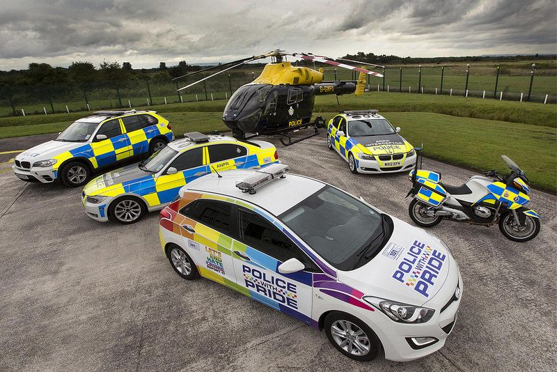 A rainbow under a dark sky british police cars