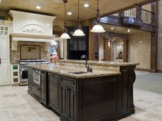 large L shaped kitchen island with stove top, sink and dishwasher ...