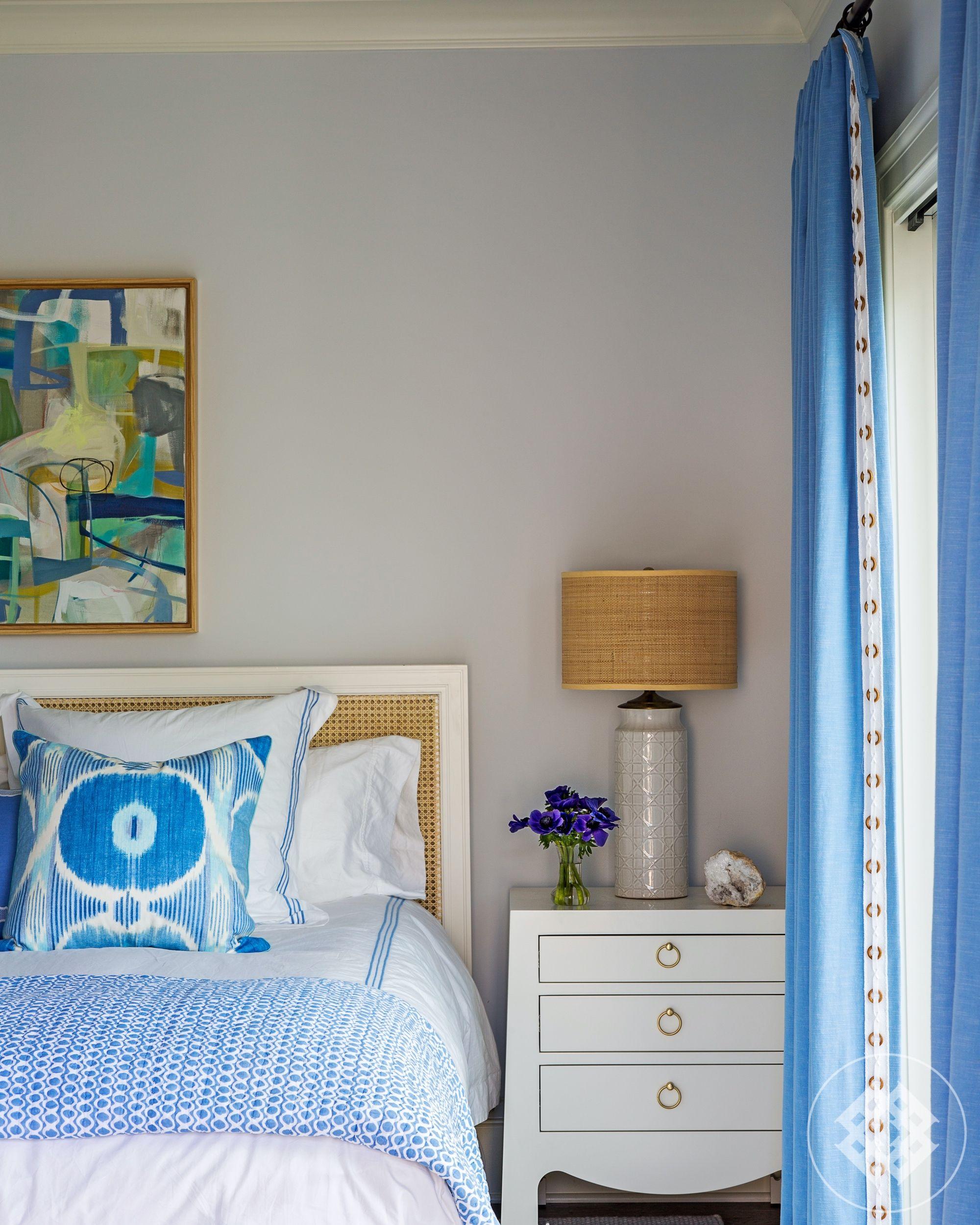 Blue bedroom, white side table, vintage lamp, burlap shad