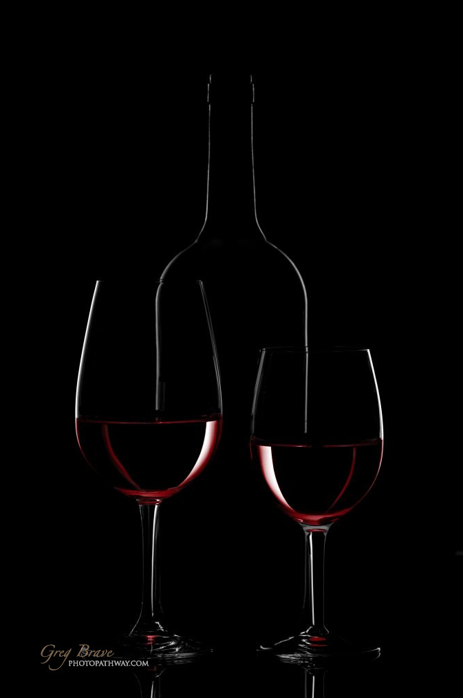 6c80197ef771 Red wine bottle and wine glass on black background