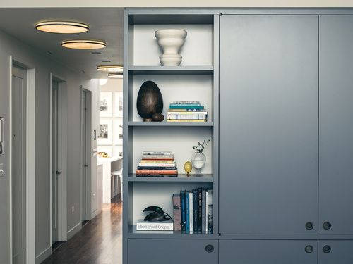Keep the end bay [closest to living] of the kitchen storage wall open to soften it