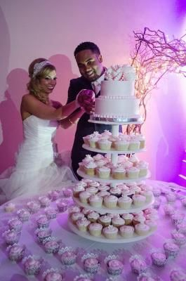 Pink And Purple Wedding Cake With A Cupcake Towers At