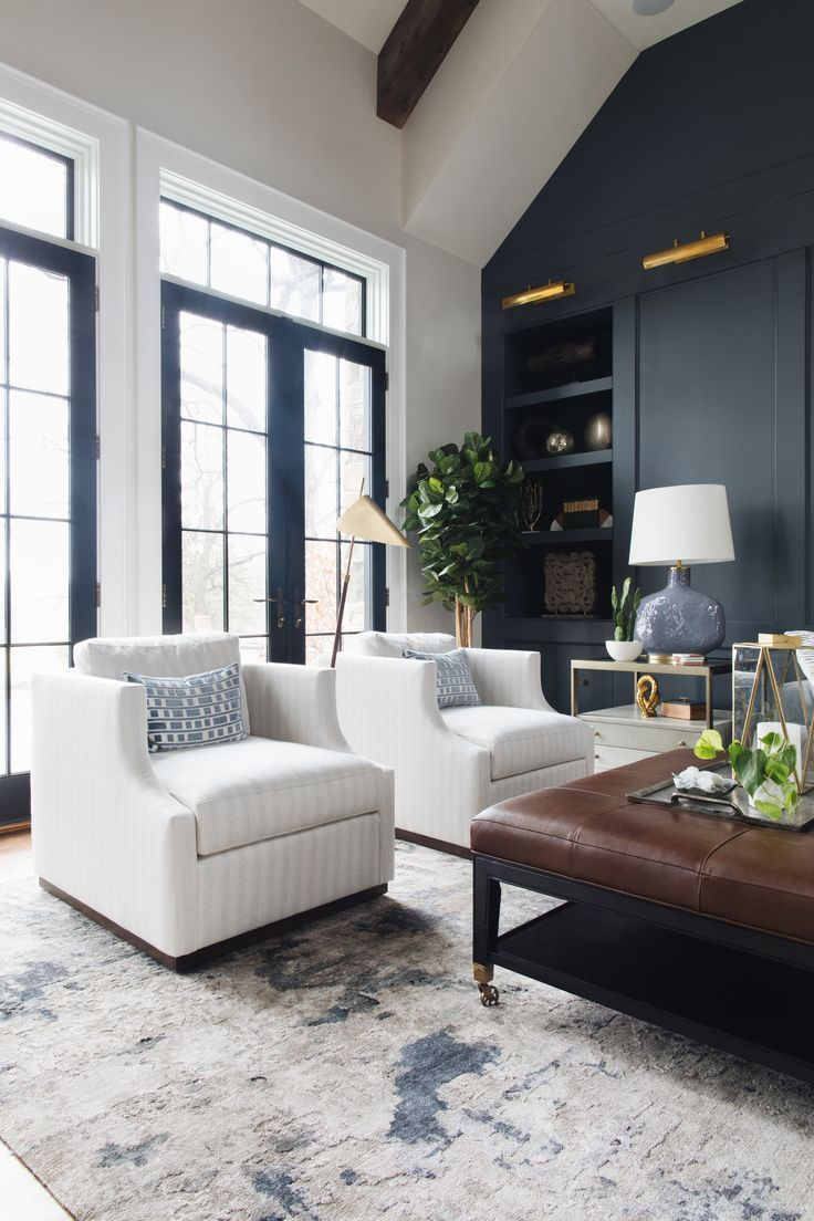 Living Room Feature Wall Designs: Light Beige Sofa/blue Tone Rug/leather Ottoman Coffee