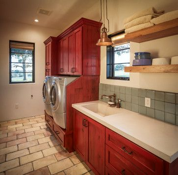 Red cabinets and floating shelves offer plenty of storage room in