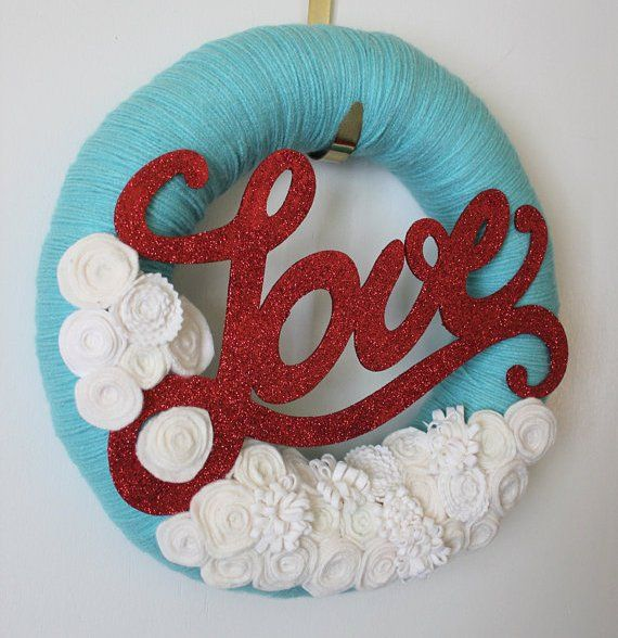 Yarn and felt Love wreath by TheBakersDaughter via Etsy