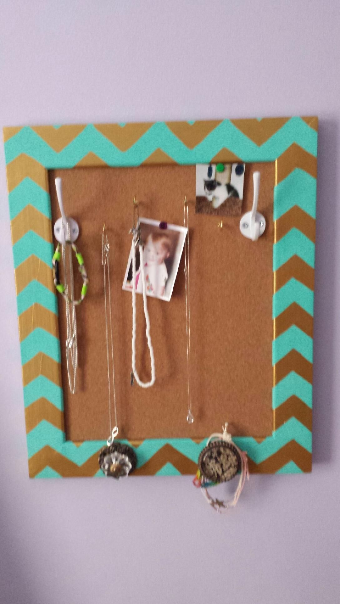 DIY Cork board jewelry holder. Made with cork board, unfinished frame, hooks, and cabinet knobs all from hobby lobby. It turns out they also sell finished products just like this that cost less than the supplies did to make it, but I think mine turned out much prettier than anything they had in store.