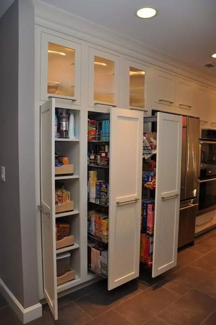 I would love to have a kitchen pantry like this! So practical and useful! Any ideas on how to do this yourself for less?   http://www.pinterest.com/pin/63050463507460117/