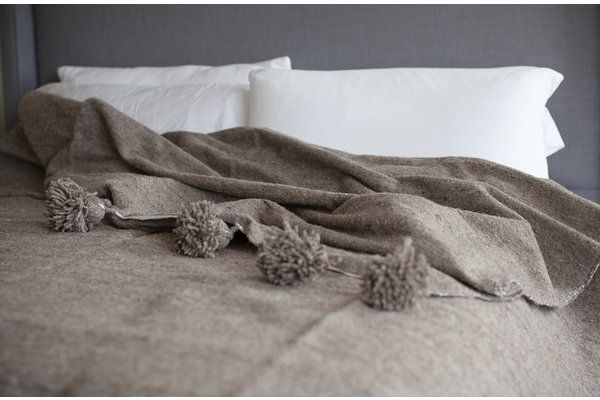 Keep cozy and warm with these 100% wool blankets! They are perfect as a bedcover, throw, blanket or a sofa covering. All blankets are loomed by hand in Marrakech by Moroccan craftsmen. They are handcrafted in Moroccan style with oversized pom's on each end. Beautiful neutral colors and patterns that match any home decor style.