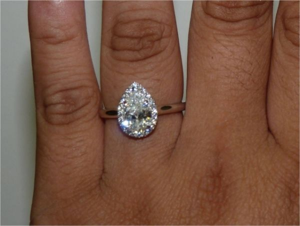 hand shot of brian gavin custom pear shape halo ring engagement ringshappy ever after - Pear Shaped Wedding Ring Sets
