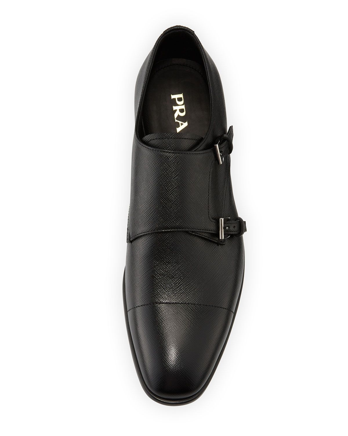 1a1d7096 Prada saffiano leather shoe. Double-monk strap across front. Cap toe.  Leather lining and insole. Stacked flat heel with metal logo insert. Rubber  outsole.