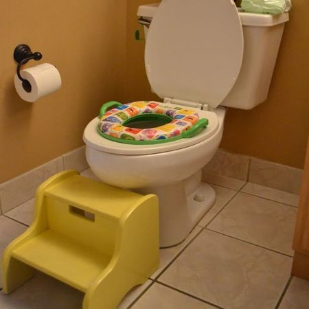 For small children a step stool that fits close to the toilet allows ...