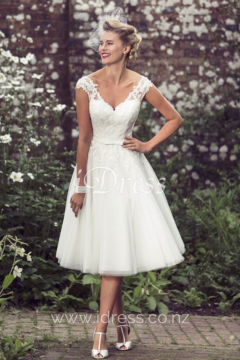 A-line wedding dress accenting with subtle lace on the v-neckline cap  sleeves bodice 2c4d6e746