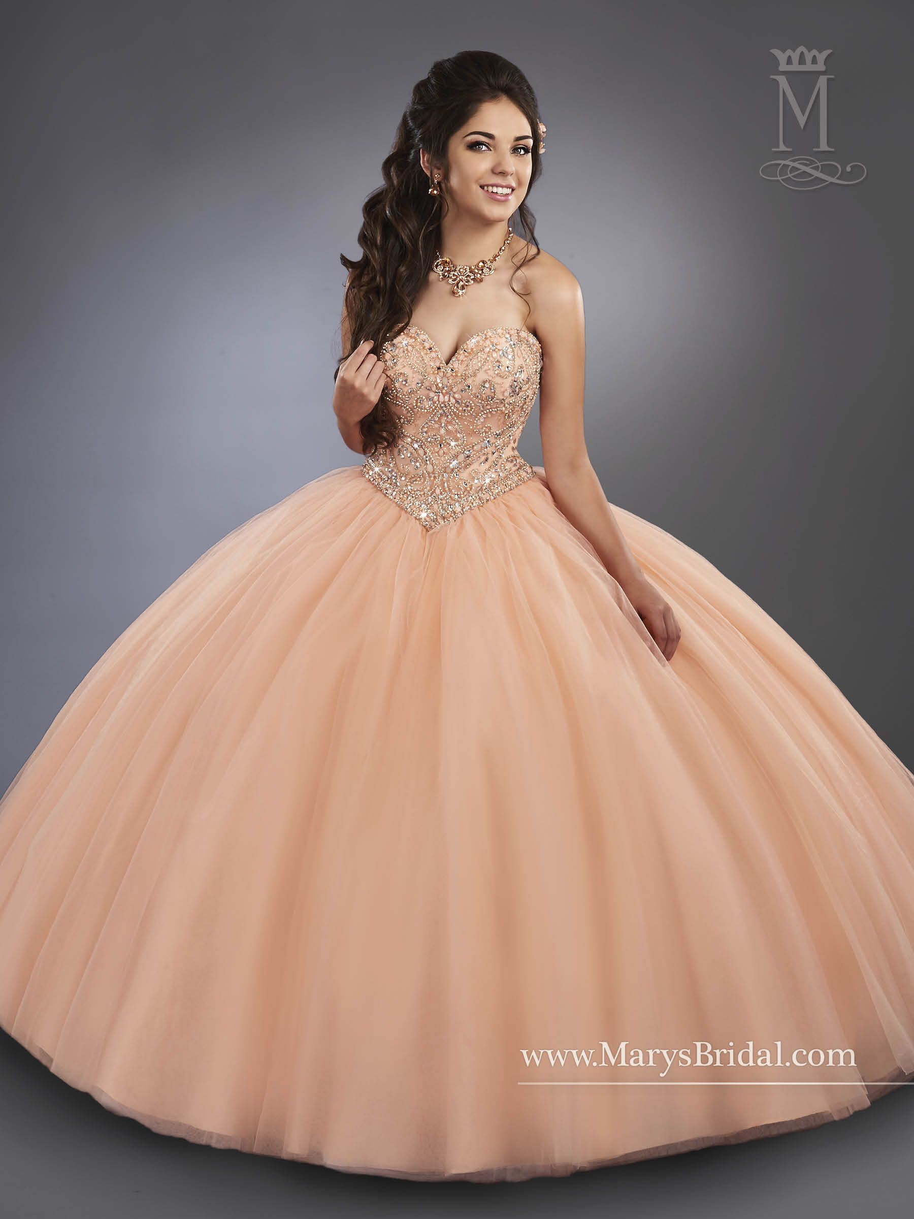 9c37a4d17f6 Beading embellishes the strapless bodice with a sweetheart neckline