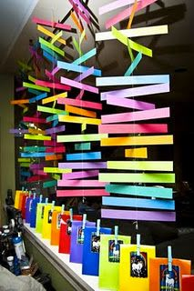 colorful paper strips sewn together and hang a pic of a book cover at the bottom
