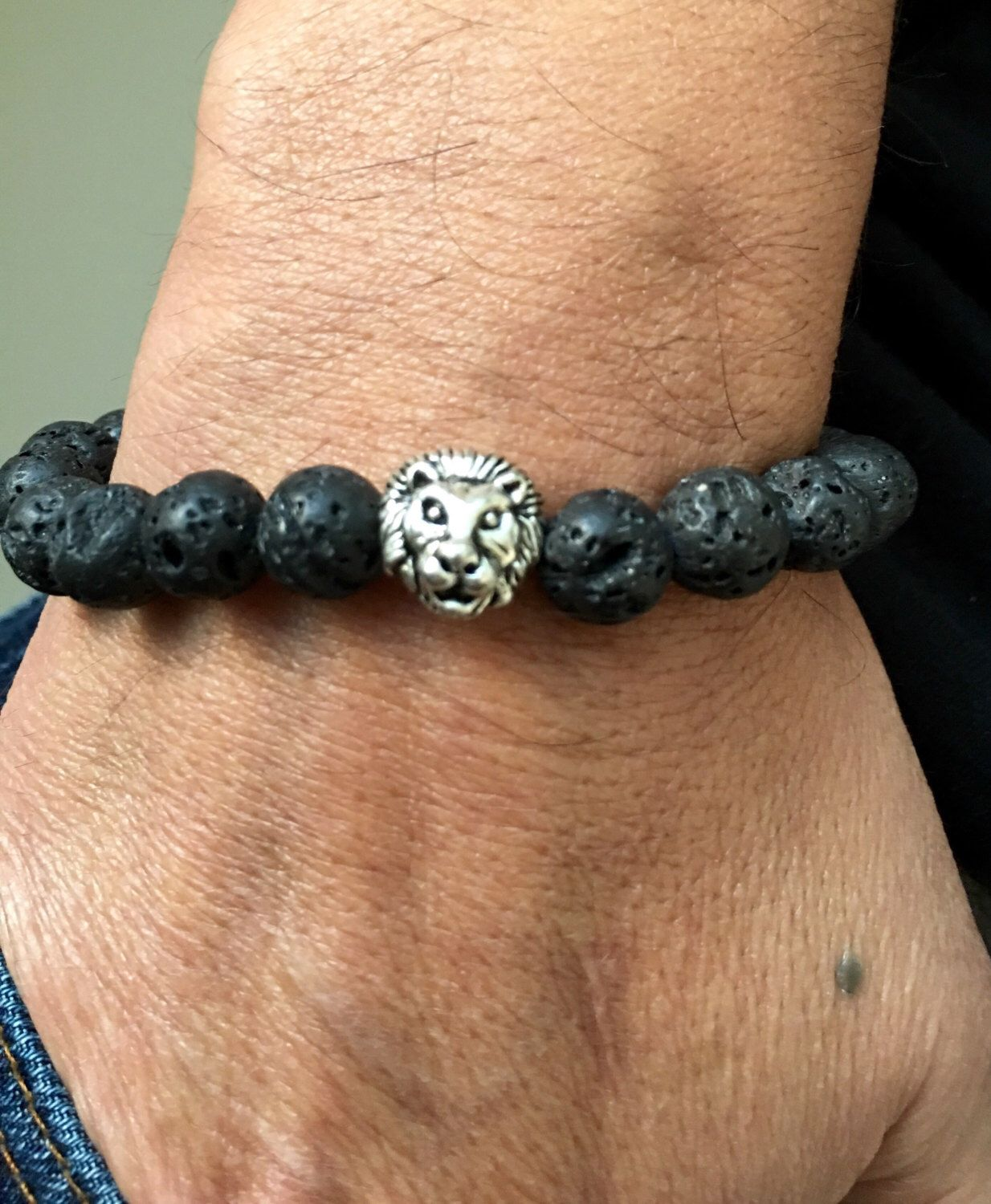 A personal favorite from my Etsy shop https://www.etsy.com/listing/480789489/silver-lions-head-black-lava-stone